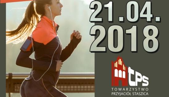 plakat z biegnącą kobietą